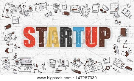 Startup Concept. Startup Drawn on White Wall. Startup in Multicolor. Doodle Design. Modern Style Illustration. Doodle Design Style of Startup. Line Style Illustration. White Brick Wall.