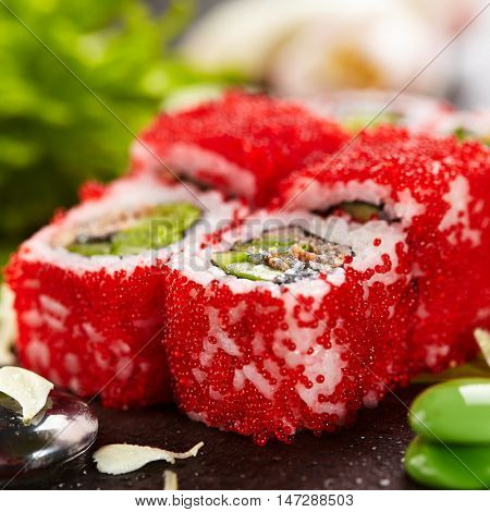 Mussel Maki Sushi - Roll made of Mussels, Lettuce and Cucumber inside. Red Tobiko (flying fish roe) outside