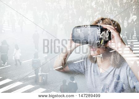 Double exposure of woman using the virtual reality headset