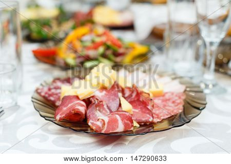 Meat cold cuts on a banquet table. shallow depth of field