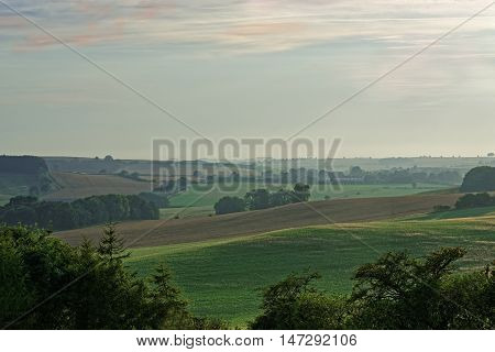 View across the hills of the Lincolnshire Wolds UK with an early autumn mist