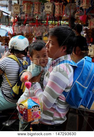 Vietnamese Father Buy Lantern For Kid