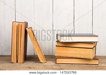 Old And Used Hardback Books Or Text Books On Wooden Background