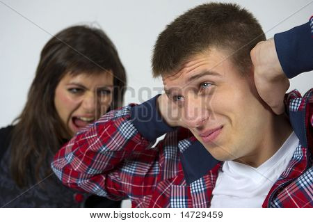 Young couple fights. over neutral background