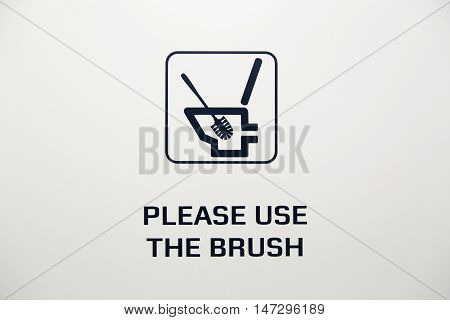 A toilet brush sign on white background
