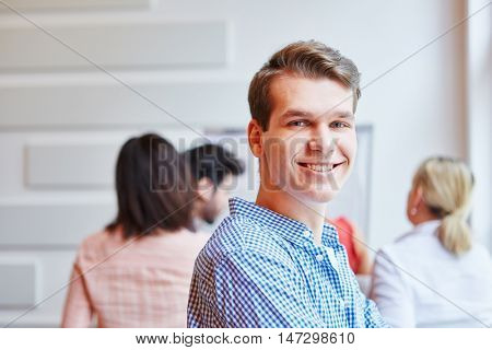 Student as succesful businessman smiling satisfied
