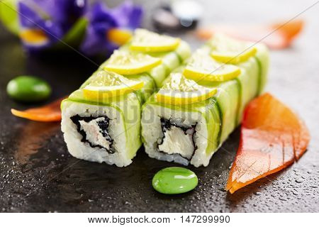 Cucumber Maki Sushi  - Roll made of Crab Meat, Cream Cheese and Black Tobiko (flying fish roe) inside. Cucumber outside. Topped with Lemon Slice