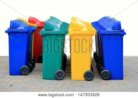 group of new large colorful wheelie bins for rubbish recycling waste