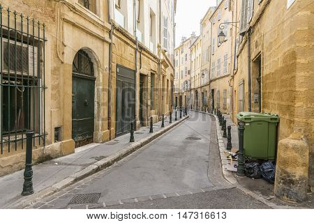AIX EN PROVENCE,FRANCE-AUGUST 9,2016:a desolate and picturesque narrow road in Aix en Provence during a summer day.