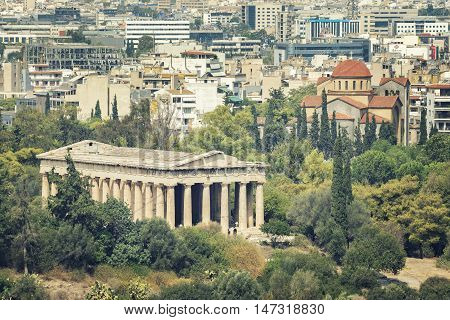 ATHENS, GREECE, SEPTEMBER 6,2016: Athens cityscape, Temple of Hephaestus can be seen on the front and Agia Triada Church at background.