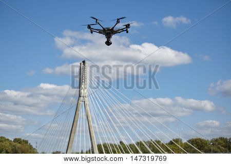 Copter flight against the blue sky. RC aerial drone. poster