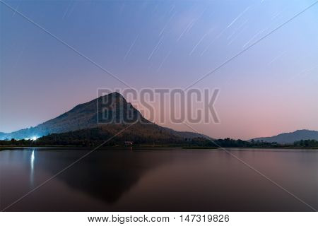 Long exposure image of mountain reflex on the lake under star and moonlight night.