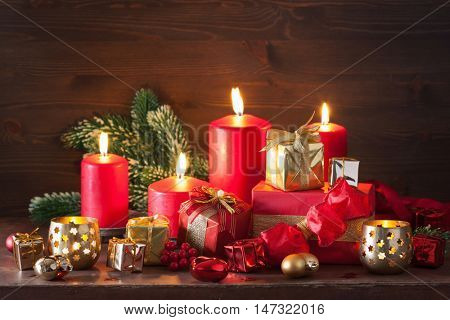 red and golden christmas gift boxes decoration candles