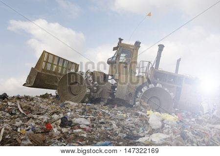 Bulldozer and rubbish garbage tip dump landfill