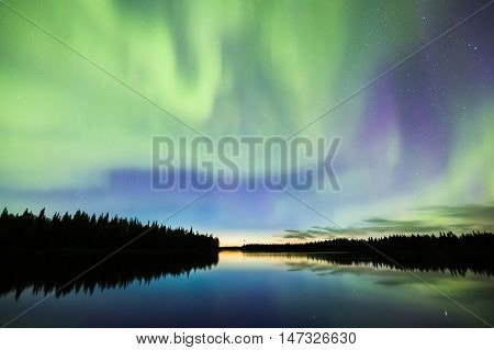 Nortehrn Lights On The Sky Above River In Lapland