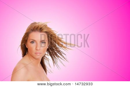 A beautiful young woman with her hair blowing