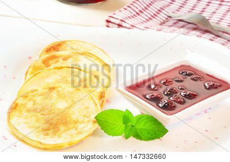 Pancakes With Cherry Jam In Square  Plate On The Wooden Table