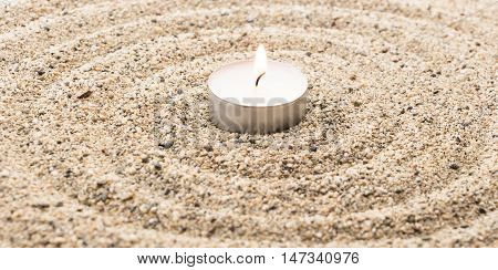 Scent Lighted Candle On Sand Imitating Water Ripples