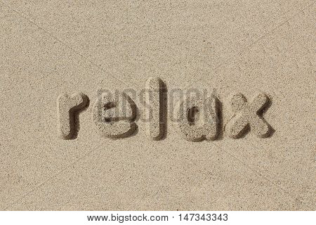 Relax written in sand letters. Very simple and graphic.