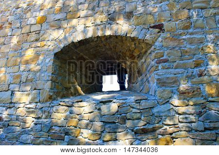Stone wall of a stronghold with embrasure