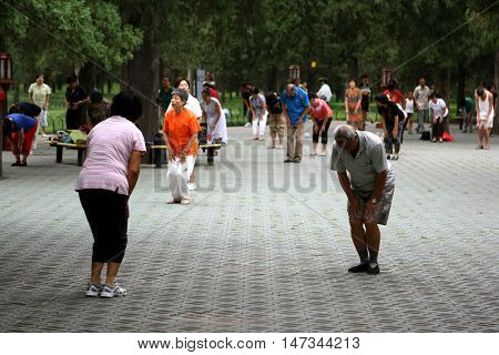 Beijing. China. - August 20, 2009 - Chinese retirees spend their leisure time in the park. Dance, doing acrobatics and Tai Chi. The streets of China in August 20, 2009 in Beijing. China.