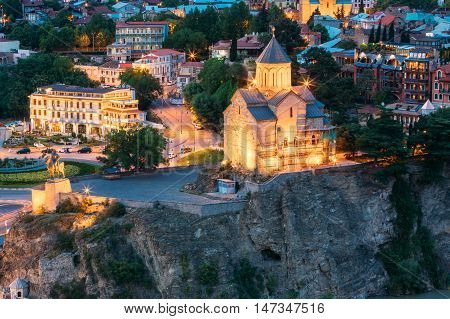 The Night Evening Illuminated View Of The Metekhi Church And The Equestrian Statue Of King Vakhtang Gorgasali On The Metekhi Cliff In Old Historic District Of Tbilisi Georgia.