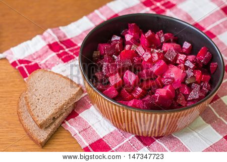 Vinaigrette is a salad in Ukrainian cuisine. It includes diced cooked vegetables (beetroots, potatoes, carrots), chopped onions and brined pickles