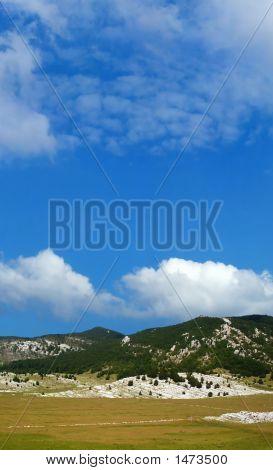 Dinara Mountain Over Blue Sky 15