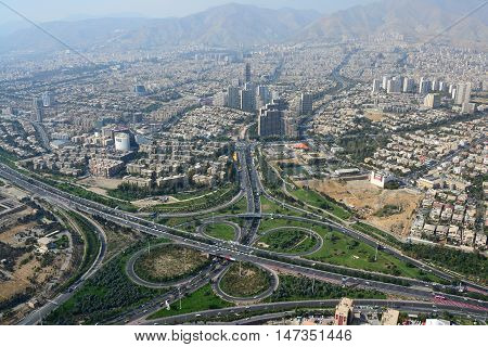 Road junction and buildings in north Tehran Iran