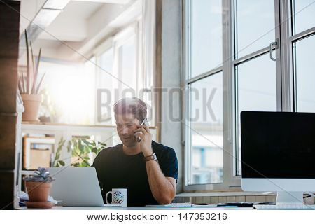 Business Man Working At His Desk