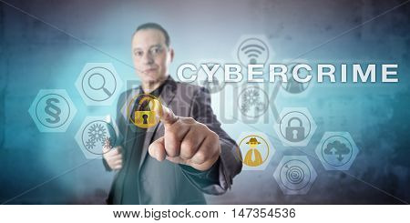 Confident but preoccupied crime investigator initiating the capitalized word CYBERCRIME onscreen. Information security concept for online harassment organized crime activity and computer attacks.