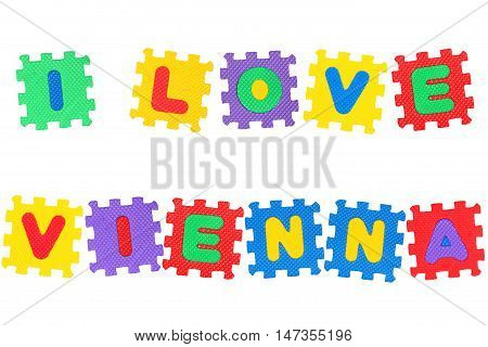 Message I Love Vienna from letters puzzle isolated on white background.