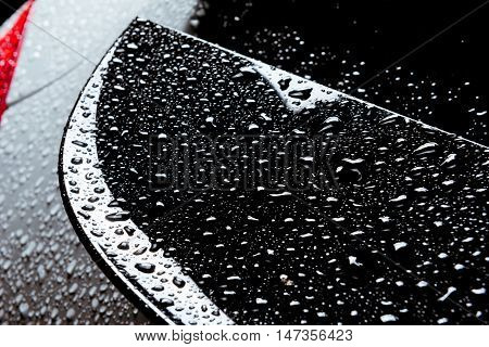 Closeup photo of the rain water drops on smooth car body