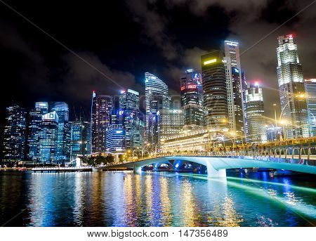 SINGAPORE - AUGUST 24 2016 : Cityscape of the business buildings at night of Marina Bay in Singapore