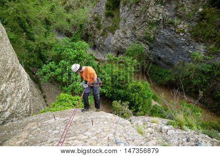 Rappelling a Ferrata in Vadiello, Guara Mountains, Huesca, Aragon, Spain.