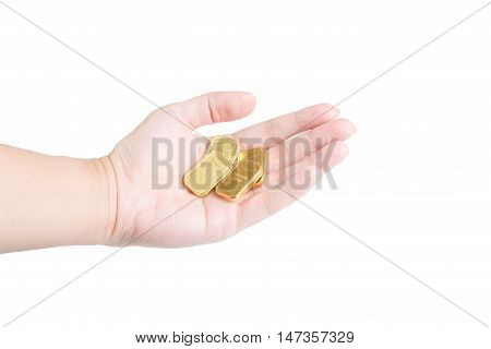 The chocolate gold coin in hand on white background clipping path