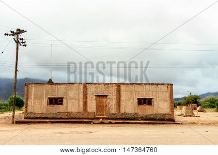 Adobe House In Front Of Mountains In Catamarca, Argentina
