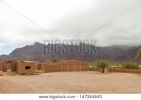 Adobe Ruins Of Houses In Front Of Mountains In Catamarca, Argentina