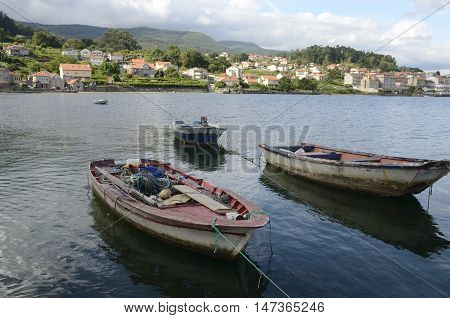 Fishing boats in the ria in Combarro a village of the province of Pontevedra in the Galicia region of Spain.