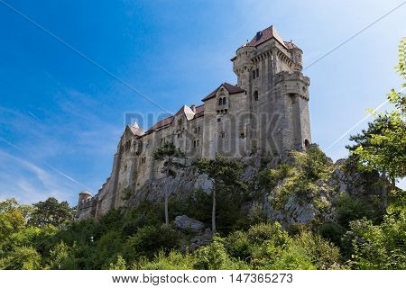 Ancient castle Liechtenstein Vienna woods village Maria Enzersdorf Austria - against bright blue sky
