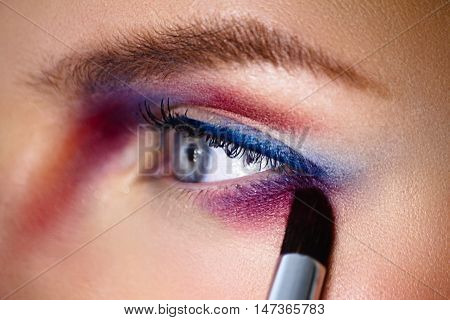 Make-up Artist Applaying  Color Eyeshadow With Brush. Close-up Photo.