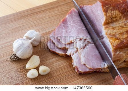 Boiled, Smoked Pork Meat, Pork Neck, Garlic And A Knife .