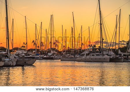 Beautiful view of Ala Wai Harbor at sunset. Ala Wai Harbor is the largest small-boat and yacht harbor in Hawaii situated between Waikiki and Honolulu downtown. Oahu in Hawaii United States.