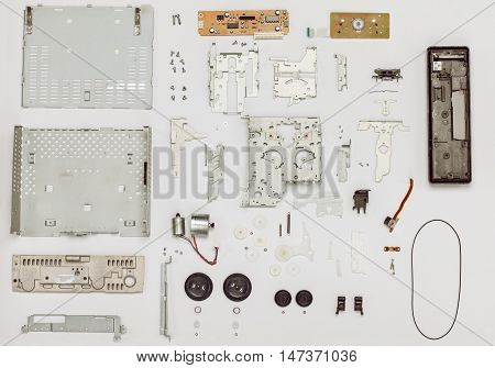Vintage cassette disassembled part player top view. Electrical and mechanical parts. Design of every part changed