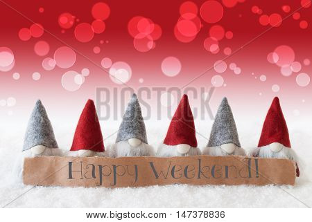 Label With English Text Happy Weekend. Christmas Greeting Card With Red Gnomes. Bokeh And Christmassy Background With Snow.