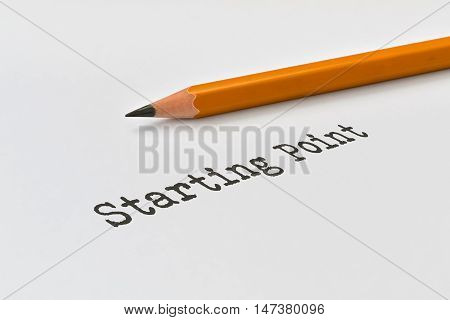 Text Starting Point and yellow pencil on bright background