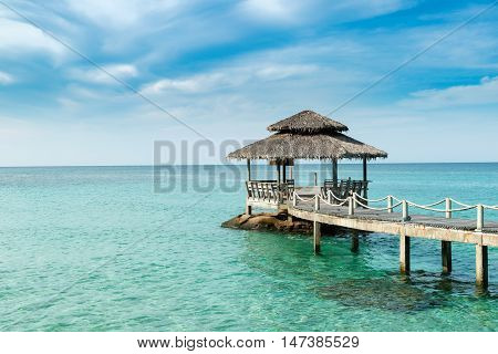 Summer Travel Vacation and Holiday concept - Wooden pier in Phuket Thailand.