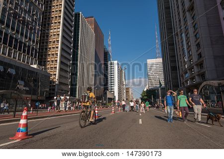 Sao Paulo, Brazil - June 26, 2016: Paulista Avenue is one of the most important financial centers of the city and is a popular place to visit among locals and city guests.