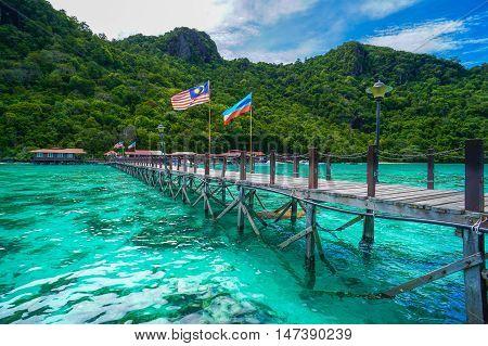 Wooden jetty heading with Sabah & Malaysia flags towards to Bohey Dulang island,Semporna,Sabah.Sabah National Park Semporna,Sabah,Borneo
