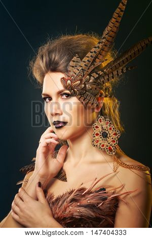 Girl harpy. Creative makeup for Halloween. The concept of mythical creature. Predatory.